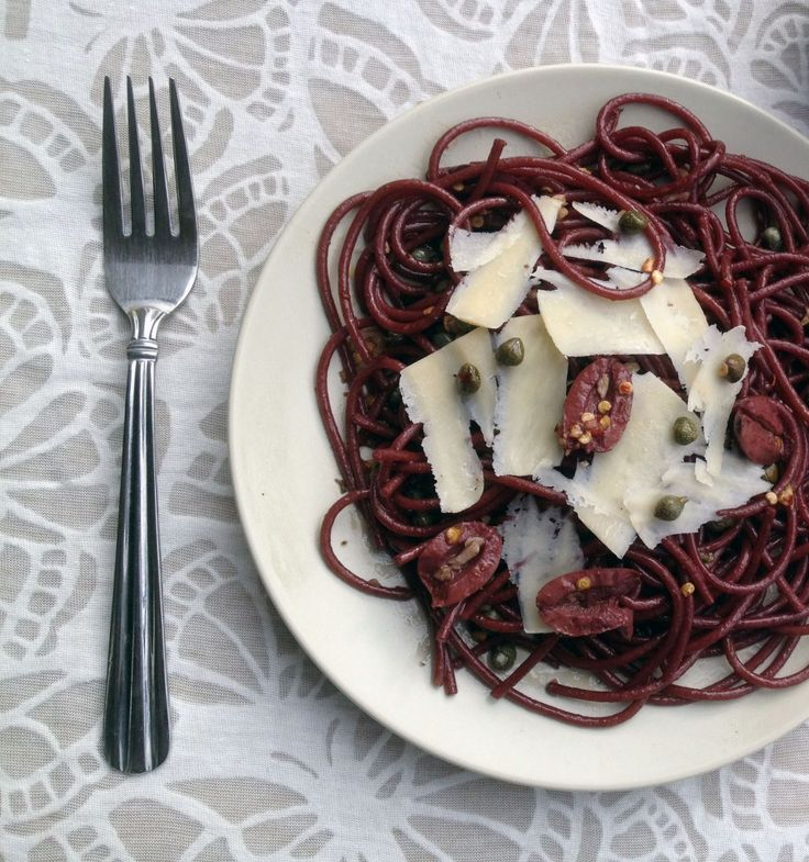 """""""Drunken Spaghetti: an Italian Favorite.""""  Boil 3 oz. spaghetti in salted water until al dente. Drain the pasta & set aside. Pour 1 cup red wine into the same pot, bring to a boil, & add the drained pasta. Cook until the pasta absorbs most of the wine (2-4 minutes.) Drain the pasta again, then toss with olive oil. Serve with olives, capers, & shaved parmesan."""