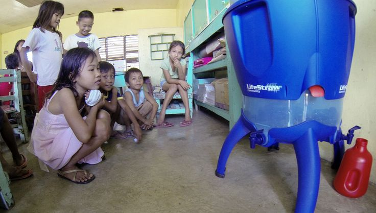 Shelterbox relief efforts providing safe drinking water to children in the Philippines - thanks to donations from Rotary of Ft Lauderdale.
