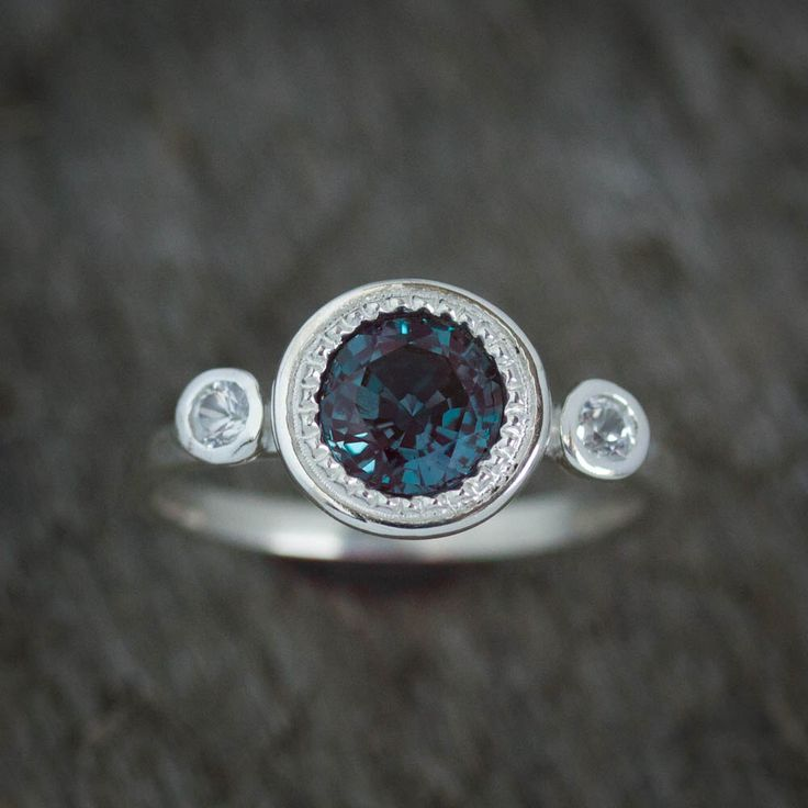 Multistone Alexandrite Ring, June's Birthstone Ring, Gemstone Halo Ring, White Sapphire and Alexandrite Jewelry, June Gemstone Anniversary by onegarnetgirl on Etsy https://www.etsy.com/listing/279878540/multistone-alexandrite-ring-junes
