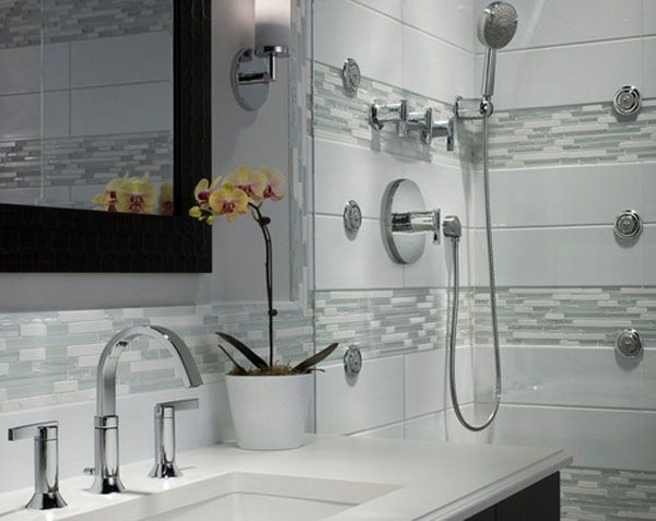 No #bathroom #design is complete without #accessories!  Who else loves that potted yellow #orchid?