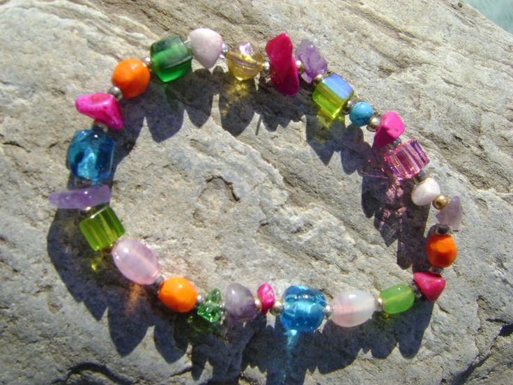 bracelet with colourful beads and little stones through elastic string---χρωματιστές χάντρες και πετρούλες σε ελαστική πετονιά