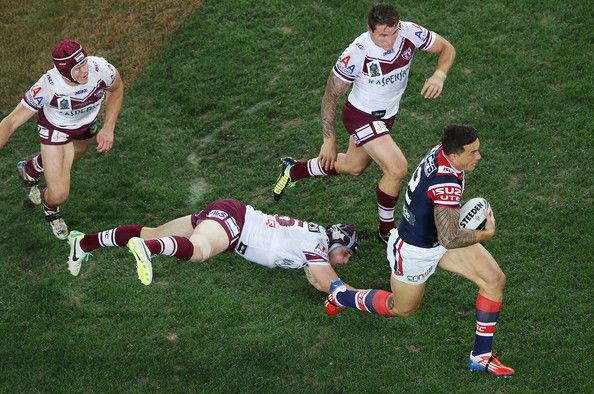 Sonny Bill Williams makes a break during the 2013 NRL Grand Final match between the Sydney Roosters and the Manly Warringah Sea Eagles at ANZ Stadium on October 6, 2013 in Sydney, Australia.