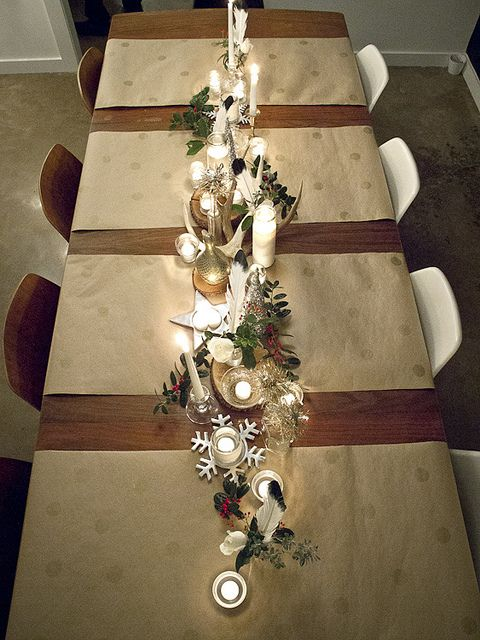 How easy is this! Perfect for thanksgiving table. stamped kraft paper, candles, feathers, silver & gold