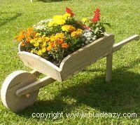 a garden wheelbarrow planter box, made mine last week just needs paint.