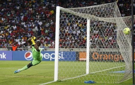 Goalkeeper Senzo Meyiwa of South Africa's Orlando Pirates is beaten by a goal made by Mohamed Aboutrika of Egypt's Al Ahli in an African Champions League final soccer match at Orlando Stadium in Soweto November 2, 2013. REUTERS/Siphiwe Sibeko/Files