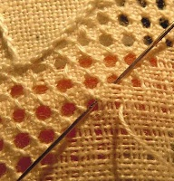Combining drawn threads with a pulled thread stitch gives a very open lacey effect.