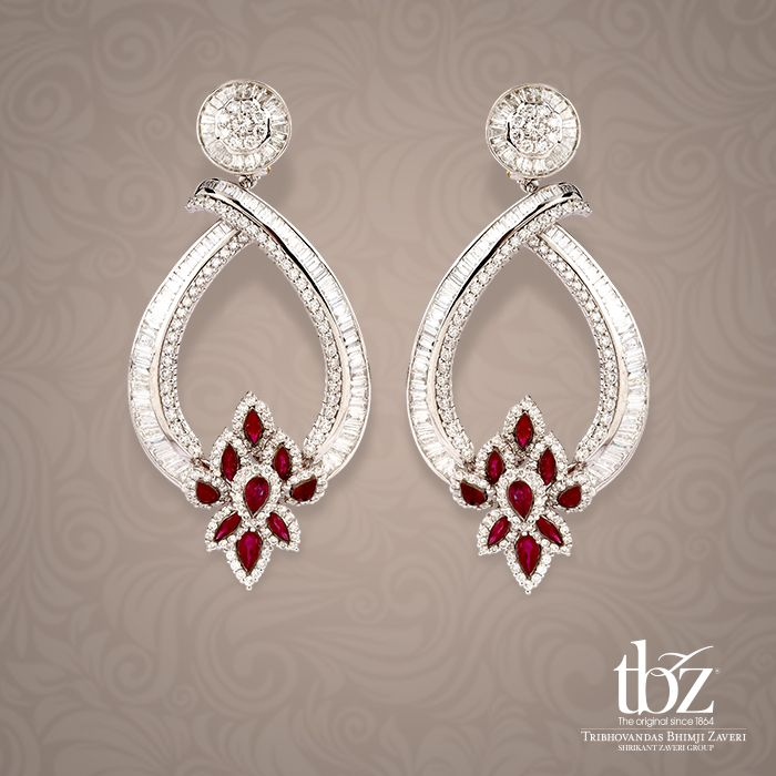 Make a bold statement as you dazzle in these chandelier earrings in diamonds and rubies