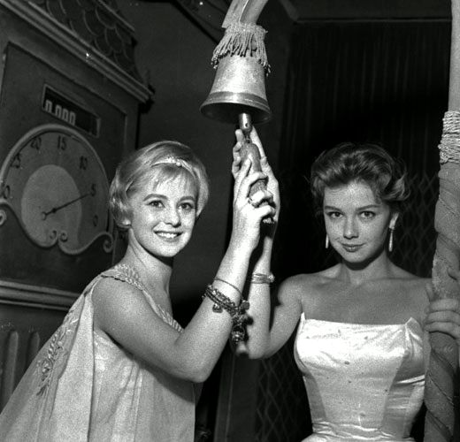 "Comedy stars Alessandra Panaro (left) and Lorella De Luca, co-presenters of ""Il Musichiere"" in 1957 and in 1958. Mario Riva called them ""le cognatine"" (the little sisters-in-law) after their roles in Dino Risi's successful comedies ""Poveri ma belli"" (English title: ""Poor but beautiful"") and ""Belle ma povere"" (English title: ""Poor girl, pretty girl"") in 1957."