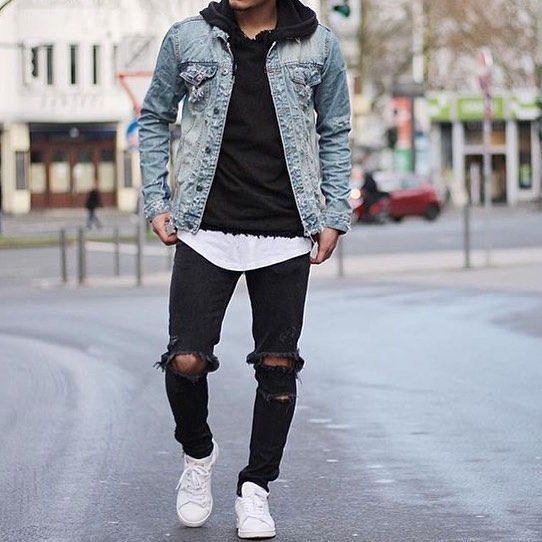 For an everyday outfit that is full of character and personality marry a light blue denim jacket with black ripped jeans. A pair of white leather low top sneakers will seamlessly integrate within a variety of outfits.   Shop this look on Lookastic: https://lookastic.com/men/looks/denim-jacket-hoodie-crew-neck-t-shirt/18753   — Black Hoodie  — Light Blue Denim Jacket  — White Crew-neck T-shirt  — Black Ripped Jeans  — White Leather Low Top Sneakers