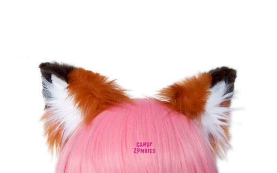 Cute and fluffy fox ears made from the softest high quality faux fur. The ears are in a brownish more natural red with brown tips and white insides. Perfect for cosplay, costumes or halloween!  Completely handsewn, no machine sewing! The plush is trimmed after sewing to get a better fox ear shape.  The ears are attached to an metal head band and can be slided up and down for your preference. They are fully wired and can be bent just how you like them. These fox ears are slightly higher than…