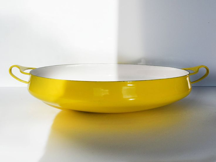 Mid Century Dansk Kobenstyle Enameled Steel Cookware, Large Sungold Yellow Paella Pan or Buffet Bowl, Jens Quisgaard design 1970s by Trashtiques on Etsy https://www.etsy.com/ca/listing/553638460/mid-century-dansk-kobenstyle-enameled