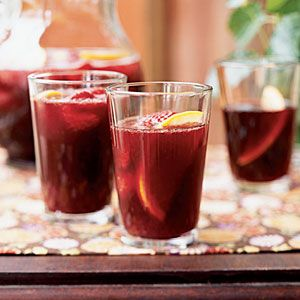 1. Combine 1 cup wine, sugar, and sachet in a small saucepan; bring to a simmer. Cook 5 minutes. Remove from heat; cool. Discard sachet. Pour mixture into a pitcher; add remaining 3 cups wine. Chill thoroughly. Add juice, strawberries, orange slices, and club soda.