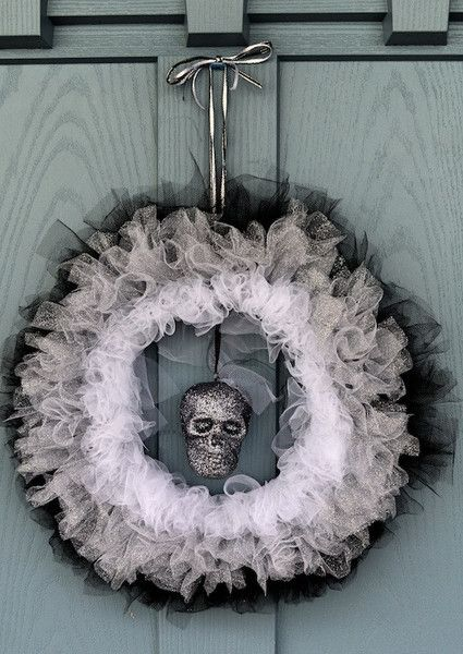 A charcoal glittered skull hanging between three layers of white, silver glitter and black tulle layered around a wire wreath frame for your desired fullness. Fluff tulle up for a messy thick look, or                                                                                                                                                                                 More
