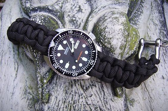 I actually have this watch, I may just have to paracord it up... the buckle is amazing!