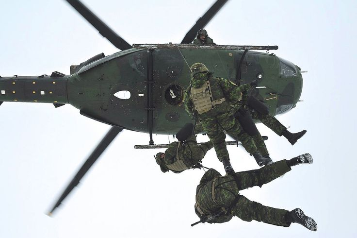 2nd Canadian Division soldiers rappel from a CH-146 Griffon helicopter during training.