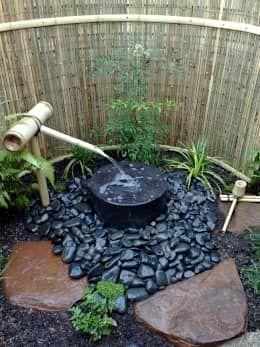 Jardines de estilo asiático por Japanese Garden Concepts https://www.homify.com.mx/libros_de_ideas/3259920/17-ideas-para-tener-un-jardin-pequeno-en-casa