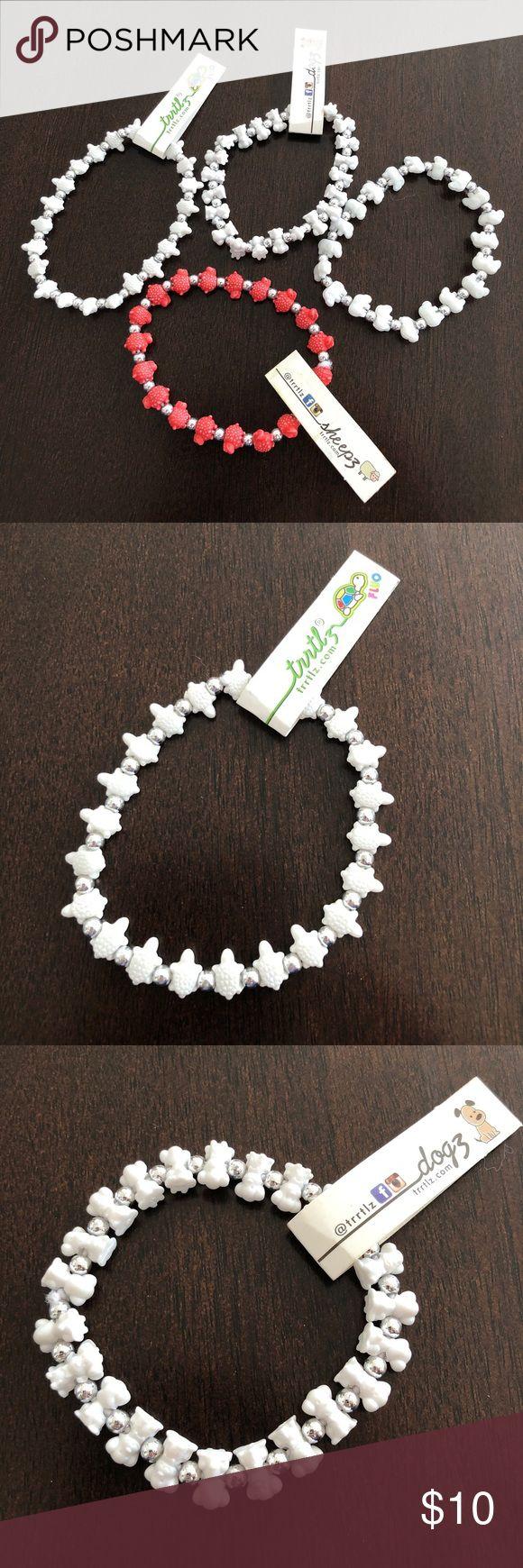 Four trrtlz bracelets Bundle has three white bracelets. One elephant, one dog & one turtle. One red sheep bracelet. trrtlz Jewelry Bracelets