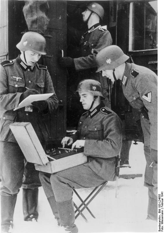 German radio men prepare to send a message encrypted on the Enigma machine.Enigma was a electro-mechanical rotor cipher machine invented toward the end of WW1. First the Poles in 1932 and then the British were able to break the Enigma cipher. It has been estimated that intelligence gleaned from decoded Enigma messages shortened WW2 by 2 years.