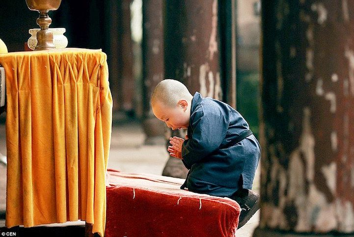 During a family holiday on January 1st, two friends decided to dress their sons up as young monks. They were visiting the Er Fo Temple in Hechuan, Chongqing and thought it would make for a brilliant photo opportunity. While the 1-year-old and 3-year-old respectfully ventured through the peaceful place of worship, the older boy's dad, Zhou Lu, had his camera ready to capture the boys with their shaved heads, traditional garb, and prayer breads. Lu was especially happy with the snapshots…