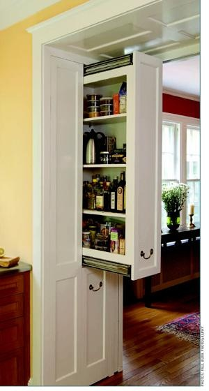 Clever storage on the inside walls of ahall/pass-through with half-tall cabinets.