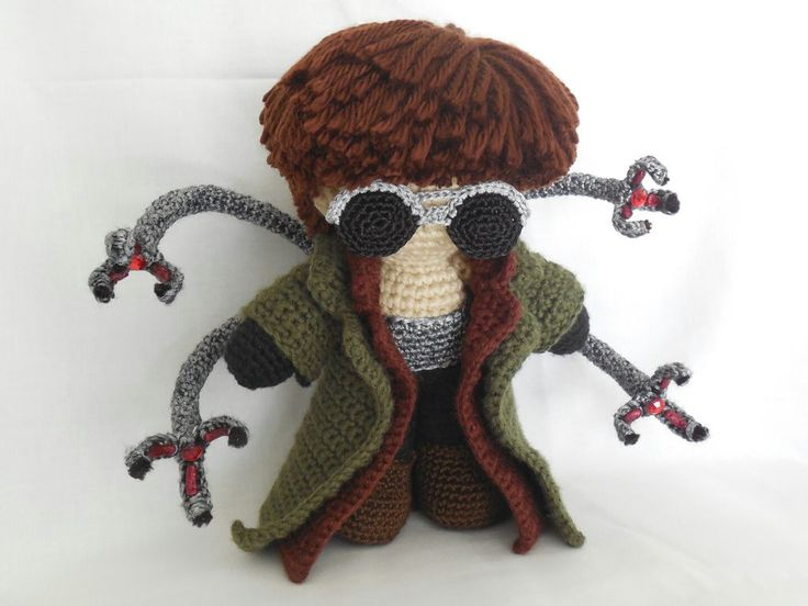 """""""Ladies and gentlemen, fasten your seat belts."""" Doctor Octopus stands approximately 5"""" tall. Materials used include Loops and Threads Impeccable in heather; Caron Simply Soft in chocolate; Knitpick..."""