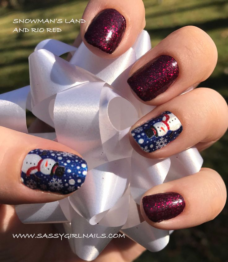 My first Color Street holiday nail set is on.  Can I just say these snowmen are fantastic!  I wanted something a little more sparkly so I paired Snowman's Land with Rio Red.    Get your's today at www.sassygirlnails.com