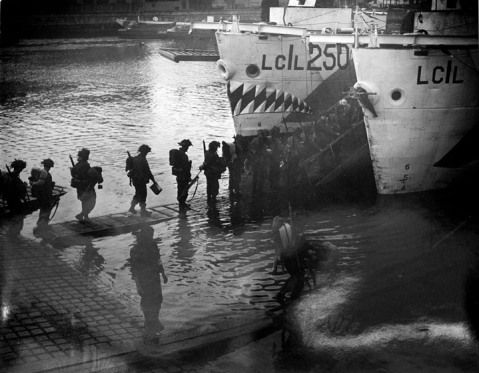 Troops from Highland Light Infantry and the West Nova Scotia Highlanders boarding in preparation for D-Day June 4, 1944 Photographer: Gilbert Milne.