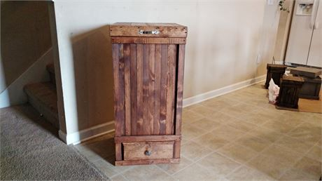 Rustic Kitchen Trash Can   This is a Wooden Trash Can for the kitchen. It is handcrafted from Reclaimed and New Wood.   This Trash Can is a 30 Gallon in Size.   The Measurements are   18 x 18 x 36   It will hold a 30 Gallon Black Outdoor Drawstring Trash Bag. The Bag fits directly inside of the Trash Can so there is no need for a Plastic Bin on the Inside.   This Trash Can was Stained using English Chestnut Stain.   The Lid is attached using Silver Hinges and a Silver Handle was added to the…