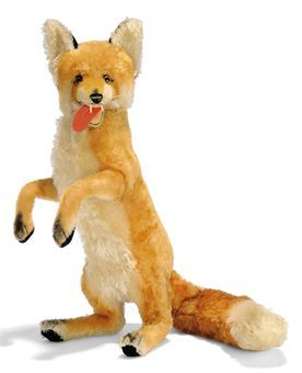 A STEIFF LARGE BEGGING DISPLAY FOX, reddish brown and white mohair, brown and black glass yes, black stitching, whiskers, open felt mouth with tongue and plastic teeth, black mohair backs to ears, swivel head and script button, 1962-71 --22in. (56cm.) high