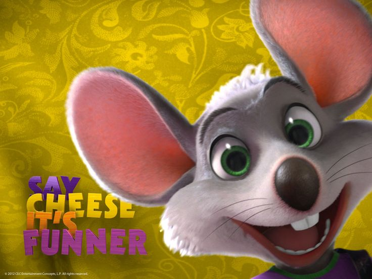 Downloadable Wallpaper Of Chuck E. With Big Smile