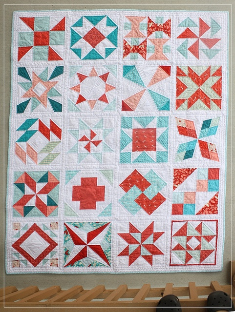 summer sampler with some coole xtra blocks. I like the pinwheel inside the star. Love the colour combo
