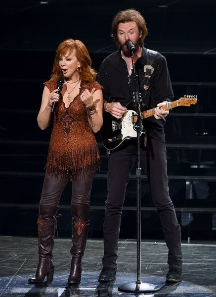 """Reba McEntire Photos Photos - Recording artists Reba McEntire (L) and Ronnie Dunn perform during the opening weekend of their residency """"Reba, Brooks & Dunn: Together in Vegas"""" with Kix Brooks (not pictured) at The Colosseum at Caesars Palace on June 19, 2015 in Las Vegas, Nevada. - 'Reba, Brooks & Dunn: Together In Vegas' Opening Weekend at Caesars Palace"""