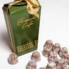 The Teuscher chocolate tradition began more than 70 years ago in a small town in the Swiss Alps. Dolf Teuscher scoured the world to find the finest cocoa, marzipan, fruits, nuts, and other ingredients with which to make his confectionery.