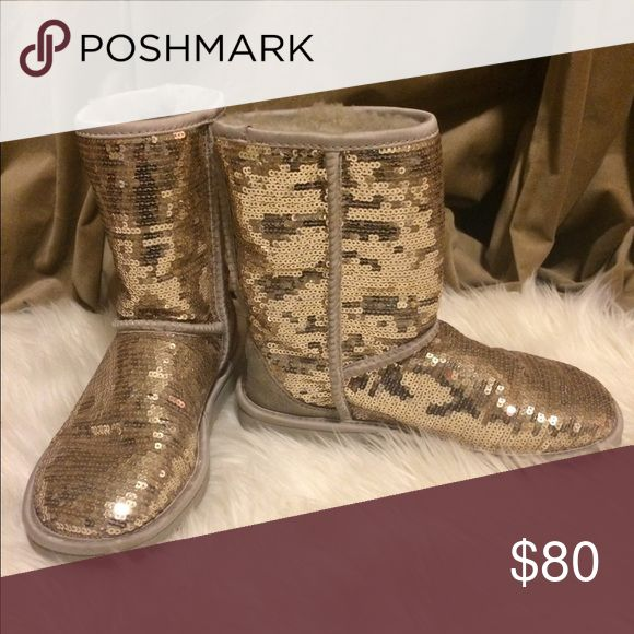 UGG Classic Short Sparkle Boot UGG Classic Short Sparkle Boot. They have been worn twice. No damage. UGG Shoes Winter & Rain Boots