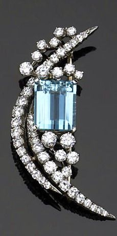 An aquamarine, diamond and platinum brooch, McTeigue the brooch featuring an emerald-cut aquamarine, accented by a crescent motif, and a fusion of randomly placed diamonds, set throughout with round brilliant-cut diamonds; makers mark for McTeigue; estimated total diamond weight: 2.75 carats.