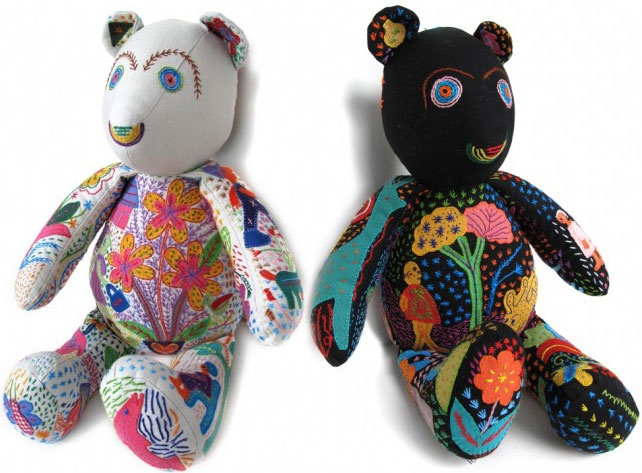 Happy and rainbow bright, these bears are a delight. Each bear is an  original work of art, featuring unique embroidery and appliqués  illustrating stories of life, animals, nature and people. Bears are  handmade in South African by women artisans and survivors of