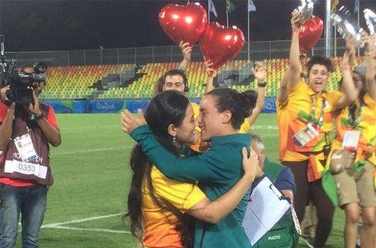 "There was a lesbian proposal at the 2016 Rio Olympics! ""Volunteer Marjorie Enya kisses rugby player Isadora Cerullo after proposing"" #LoveIsLove"