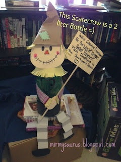 Fall Scarecrow craft!   Use a 2 liter bottle, paper and glue to create a charming and inexpensive little scarecrow friend.