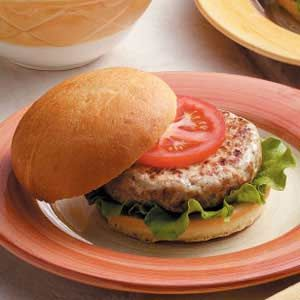 "Moist Turkey Burgers Recipe -""Although I've tried a number of turkey burgers, I always thought they were too dry,"" says Shirlea Ann Roman of Jamestown, New York. ""Cooking the onion first before adding it to the patties makes these burgers moist and flavorful."""