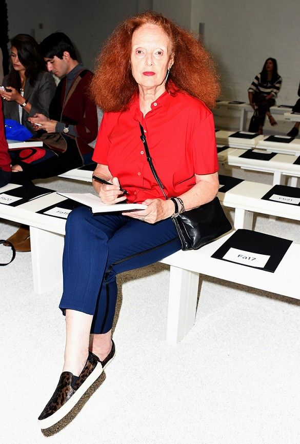 Grace Coddington sits front row in a red button up and leopard print sneakers