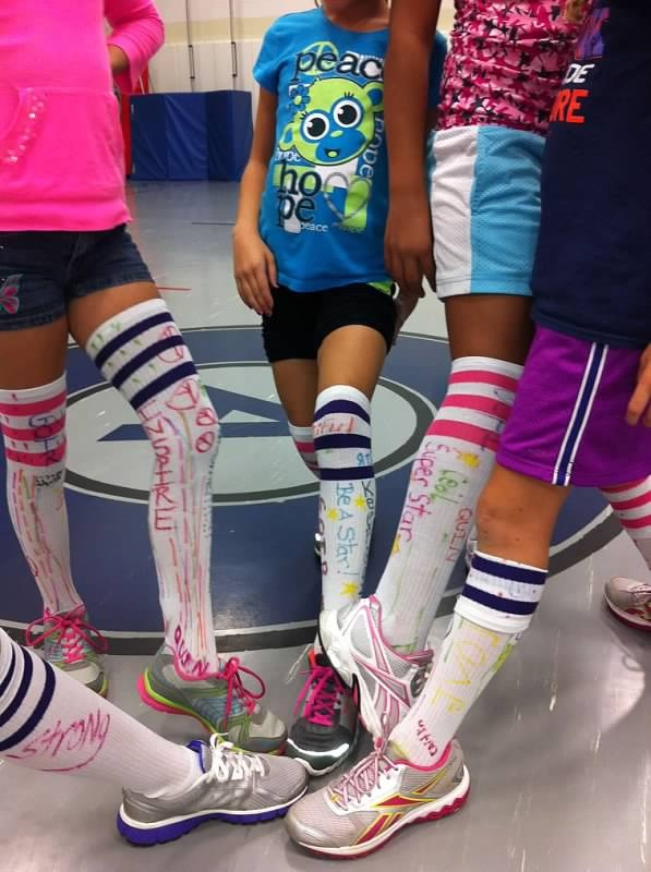 Cute idea for the 5k...knee high socks signed by team with loving words/quotes