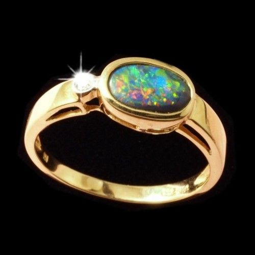 Rare red, green, blue black opal ring from Lightning Ridge set in 18k gold with a diamond to set it off. Ring comes with FREE SHIPPING and Velvet Gift Box