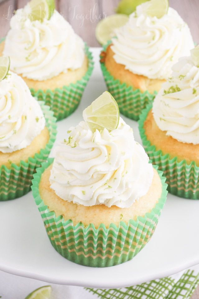 These Key Lime Pie #Cupcakes are light and fluffy, filled with sweet key lime curd and topped with a whipped vanilla lime frosting! #dessert #desserts