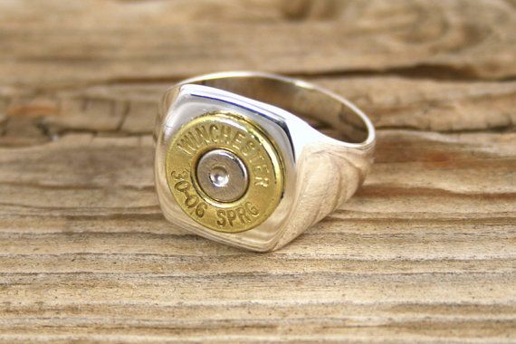 Mens Sterling Silver & Brass Bullet Ring. $49.95, via Etsy.