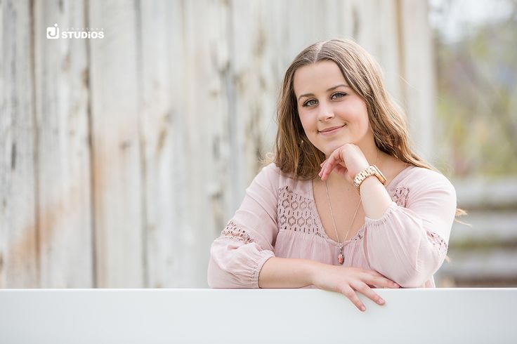 Nothing like a soft pink blouse and a white backdrop for a beautiful, soft portrait! Reno Senior Photography by Johnstone Studios