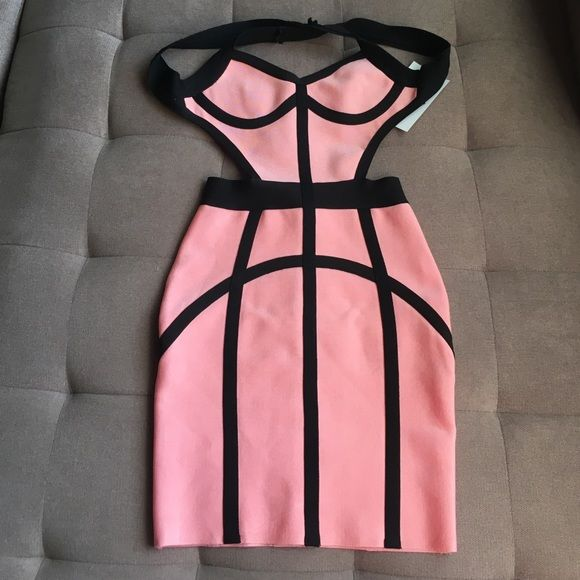 NWT and never worn bandage dress. Super flattering Comes with free gift! Celebrity boutique sexy bandage dress! Color is blush pink with black accents. Bought brand new never worn from the boutique, Shop Fashion Therapy for $230. They are known for their dresses being worn by celebrities at a lower cost than designer dresses! Shop Fashion Therapy Dresses