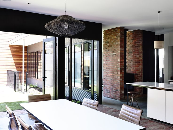 Northcote Residence by Wolveridge Architects is a contemporary home in inner Melbourne that uses recycled timber, polished concrete, recycled bricks and native vegetation. It is an extension to a heritage cottage