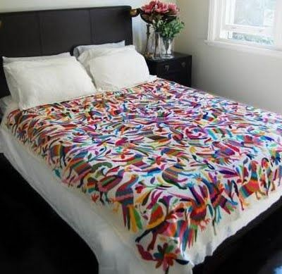 rainbow otomi on the bed...brings in the color of the flowers.  great space.