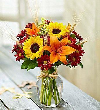 Orange tiger lillies and sunflowers