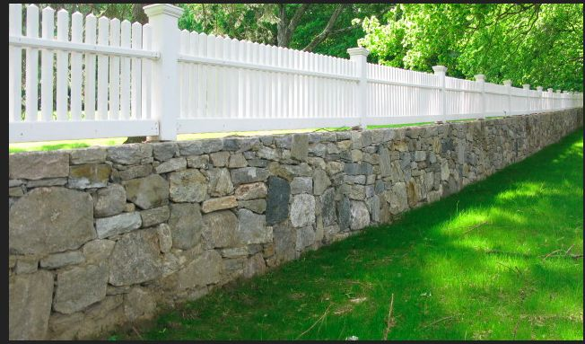 Stone wall fence with timber balustrade. LOVE this!